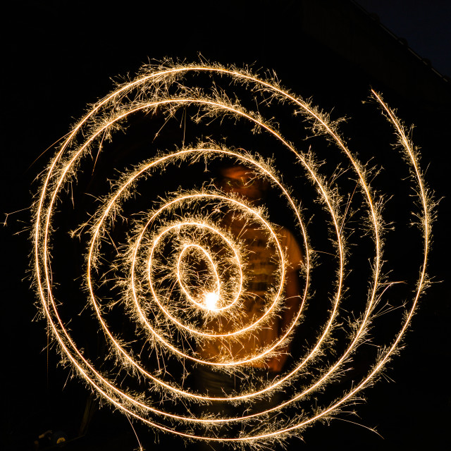 """Guy making a spiral with fireworks"" stock image"