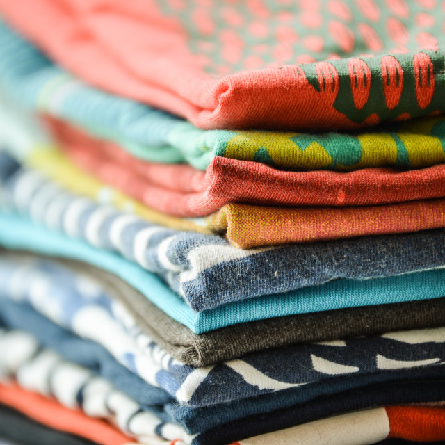 """Pile of T-shirts"" stock image"