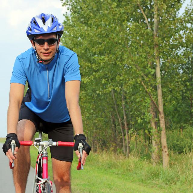 """male cyclist on a race bike portrait"" stock image"