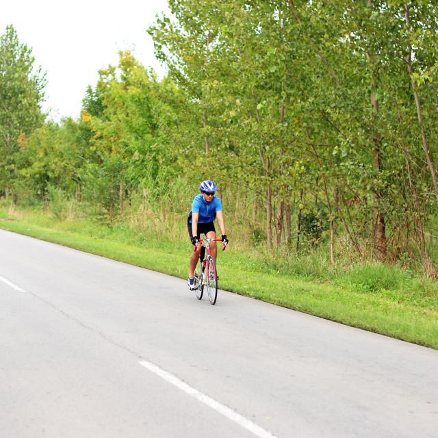 """male cyclist on a fast race bike"" stock image"