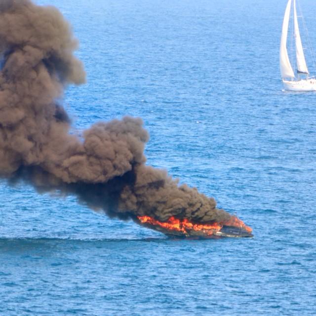 """""""Burning boat at sea"""" stock image"""