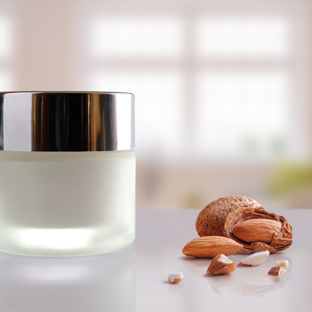 """Almond moisturizer cream jar closed windows background"" stock image"