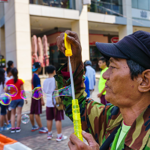 """""""The Old man with bubble wand"""" stock image"""