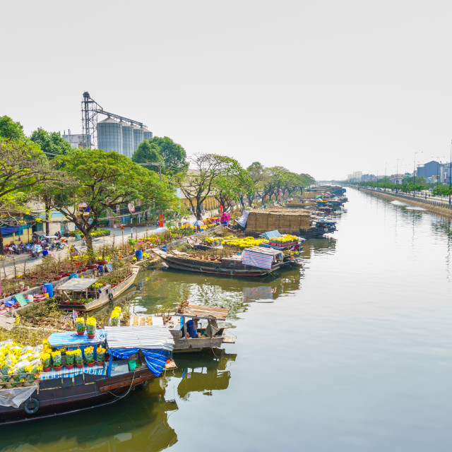 """The canal with flowers boats"" stock image"