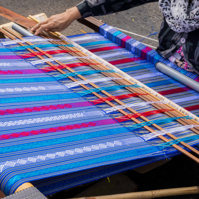 """Hand of the woman weaves traditional fabric"" stock image"