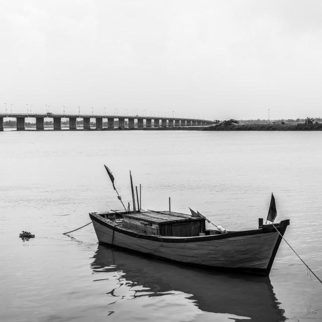 """Skyline with bridge and boat, B&W"" stock image"