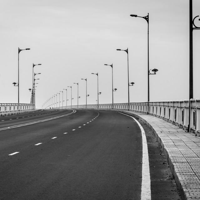 """Black and white image of the walkway on bridge"" stock image"
