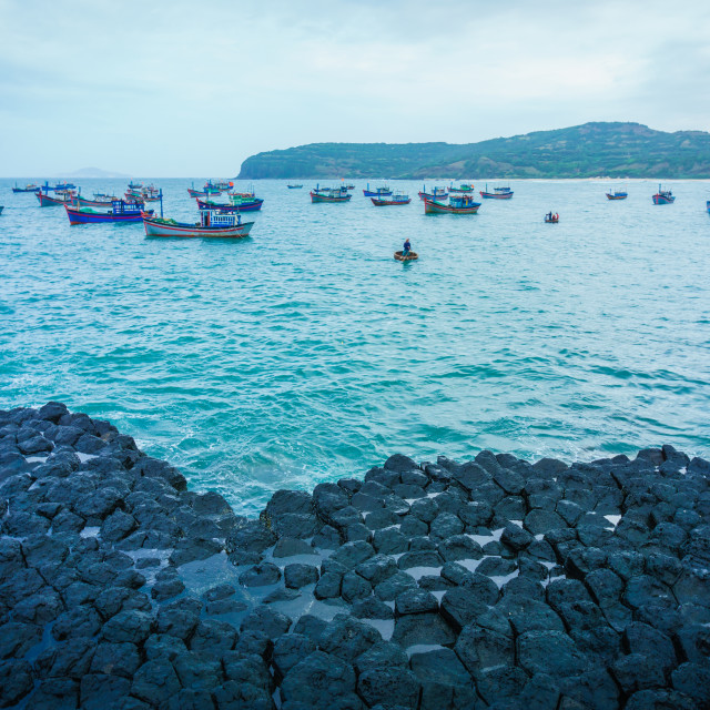 """""""GanhDaDia giant's causeway and boats in cloudy"""" stock image"""