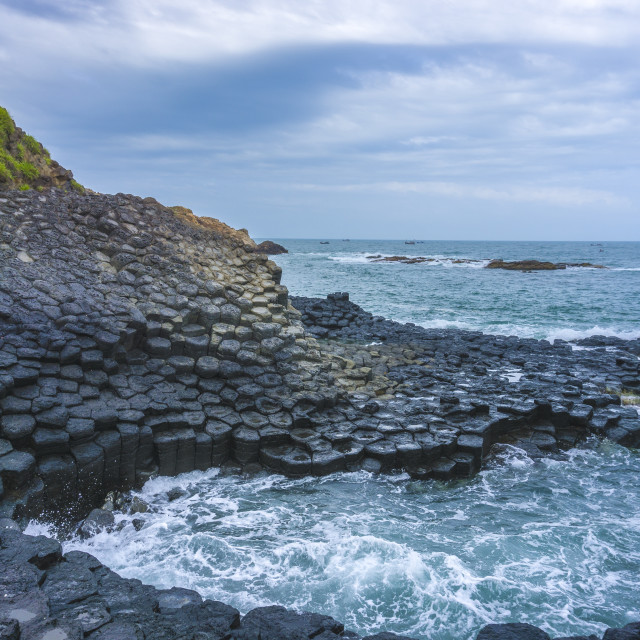 """Waves splashing on stones from the Giant's Causeway"" stock image"