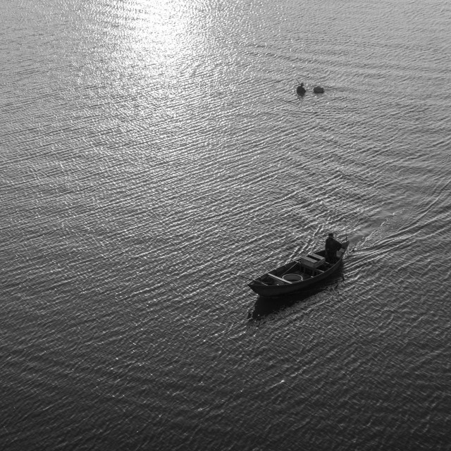 """Alone boat in the river. B&W"" stock image"