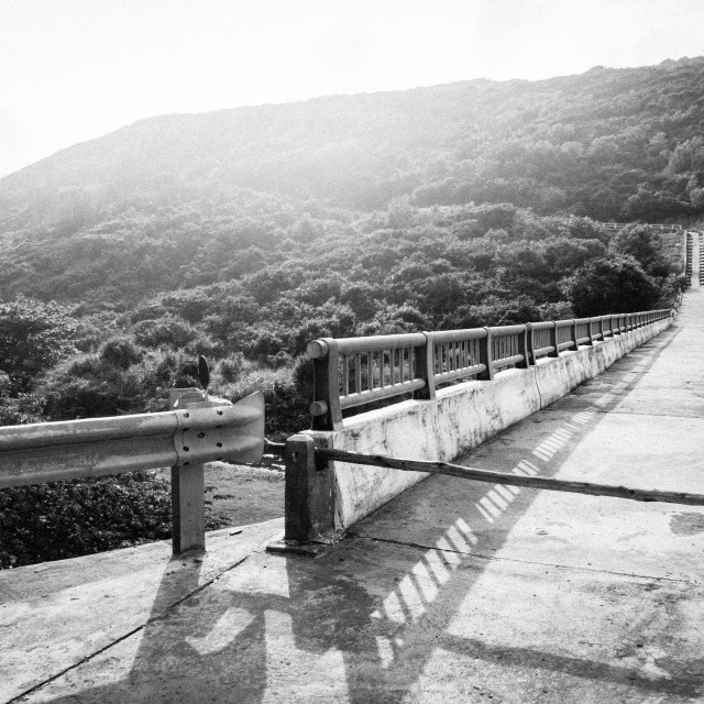 """Road in the mountains at sunset. B&W"" stock image"