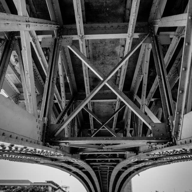 """The steel lines under a bridge. Black and white"" stock image"