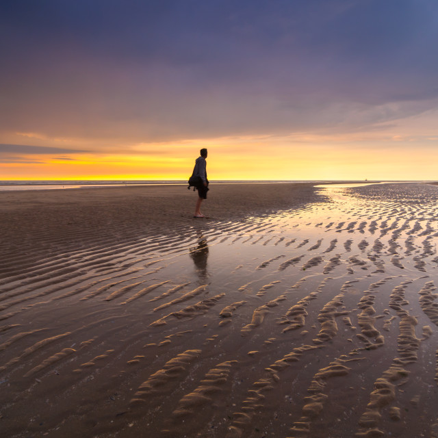"""""""Young male at the beach during sunset"""" stock image"""