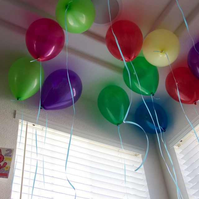 """Balloons on ceiling at birthday party"" stock image"