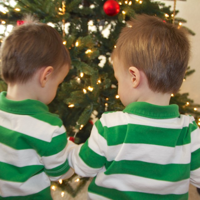 """Children looking at Christmas Tree"" stock image"