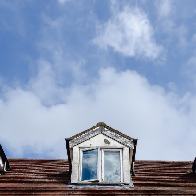 """Dormer windows and clouds"" stock image"