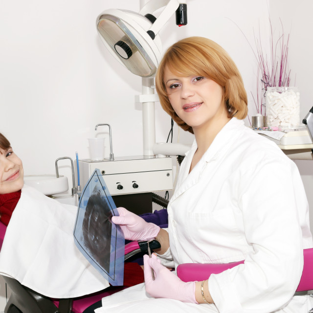 """""""female dentist with x-ray and little girl patient"""" stock image"""