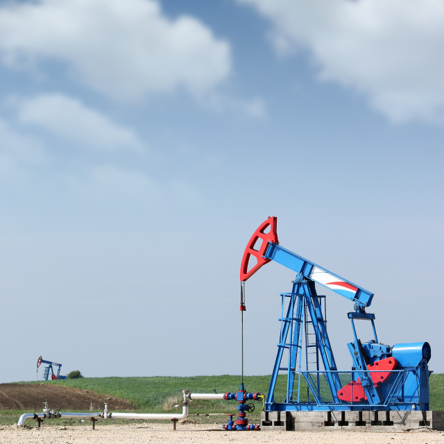 """""""two oil pump jack on oilfield"""" stock image"""