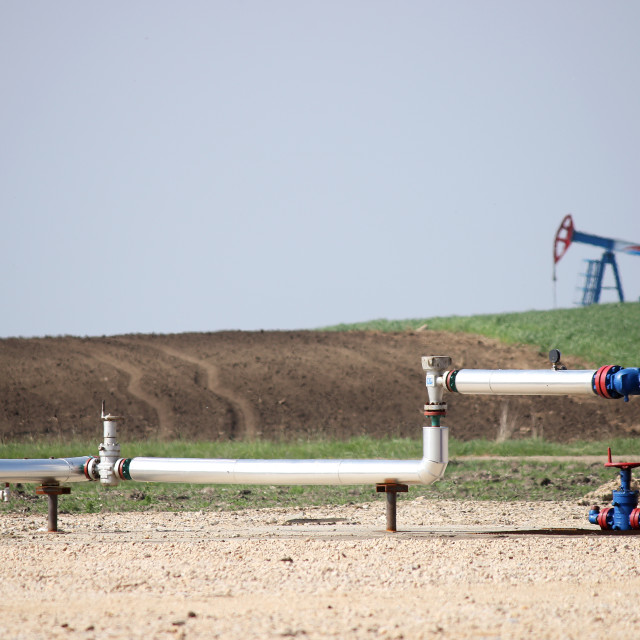 """""""pipeline and oil pump jack on oilfield"""" stock image"""
