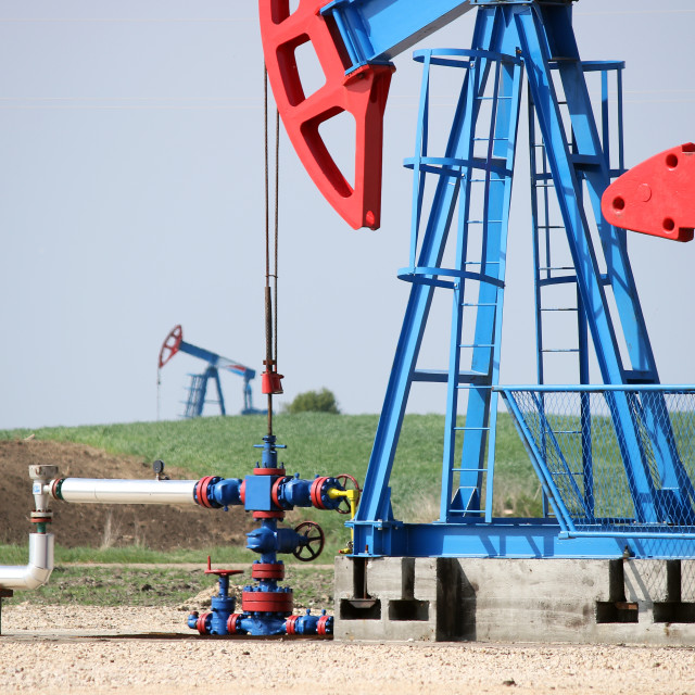"""""""two oil pump jack and pipeline"""" stock image"""