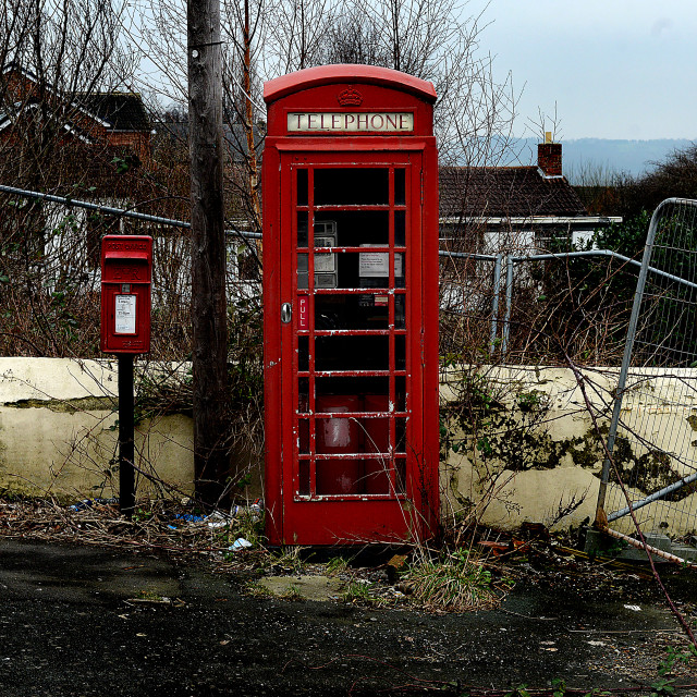 """Derelict Red British Telecom Phone Box"" stock image"