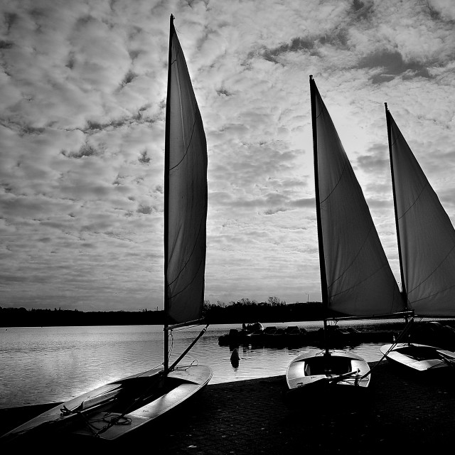 """Sail Boats at Dusk"" stock image"