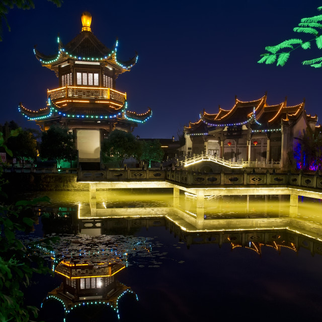 """Illuminated Chinese pagoda at dusk."" stock image"