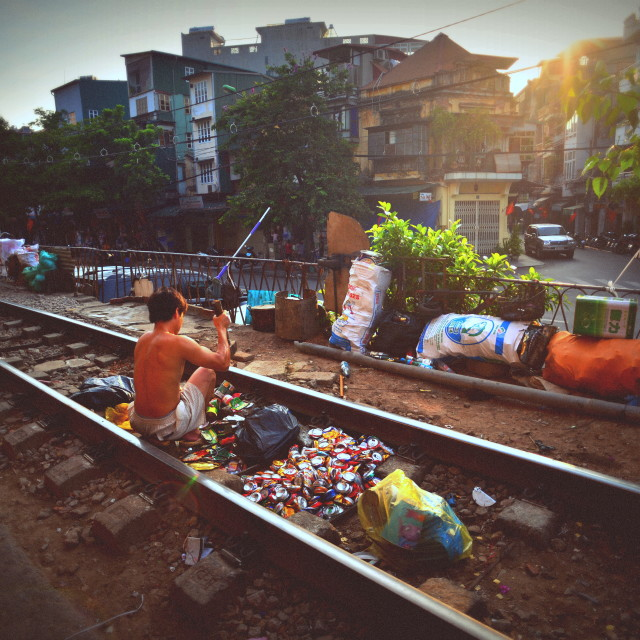 """""""Man recycles trash on the railway"""" stock image"""
