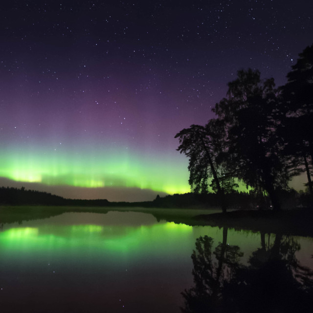 """Aurora borealis over lake"" stock image"