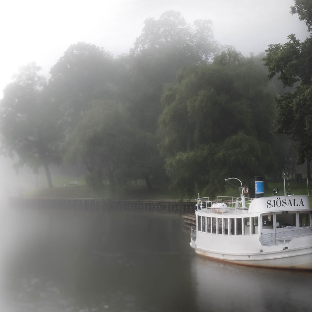 """Boat in misty morning"" stock image"
