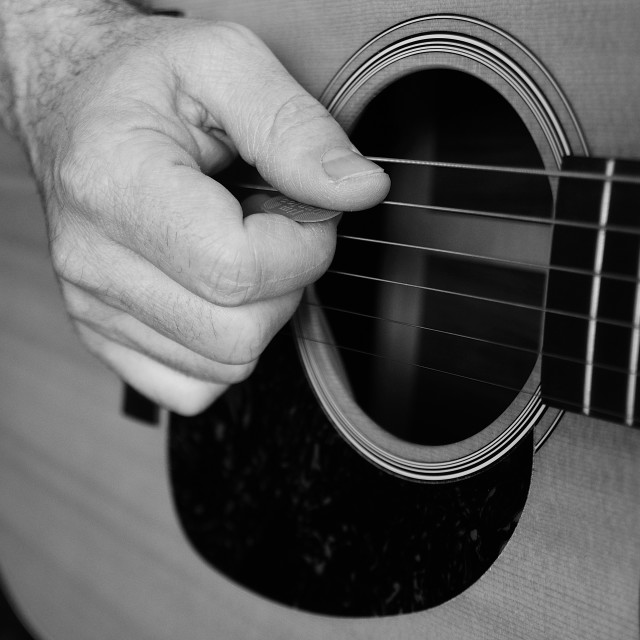 """Playing guitar/Je joue de la guitare"" stock image"