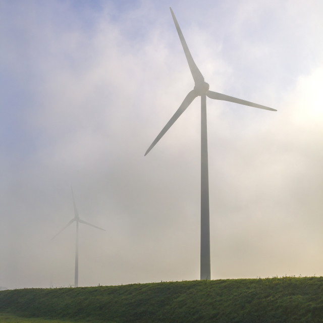 """""""Windturbines in the fog"""" stock image"""