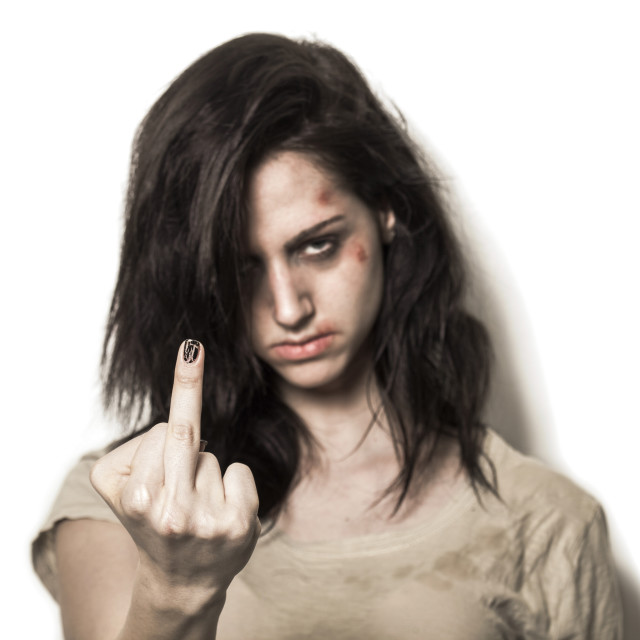 """Beaten up girl showing middle finger"" stock image"