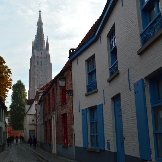 """Bruges alley & Notre-Dame Church"" stock image"