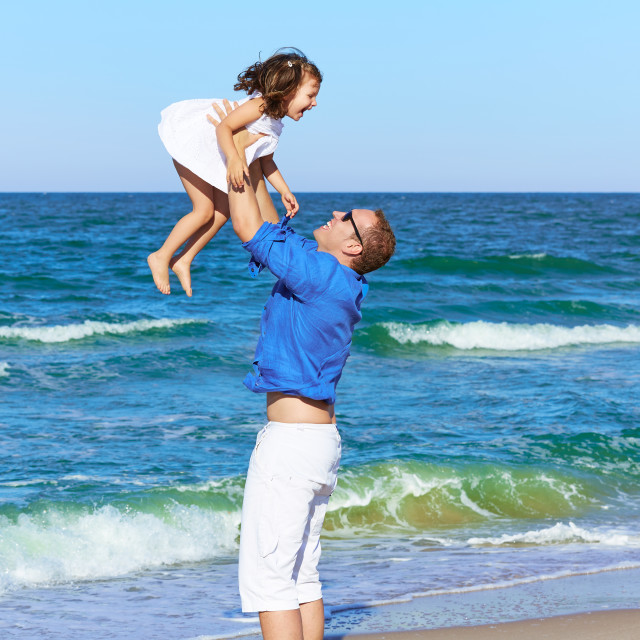 """Family father holding daughter playing beach"" stock image"