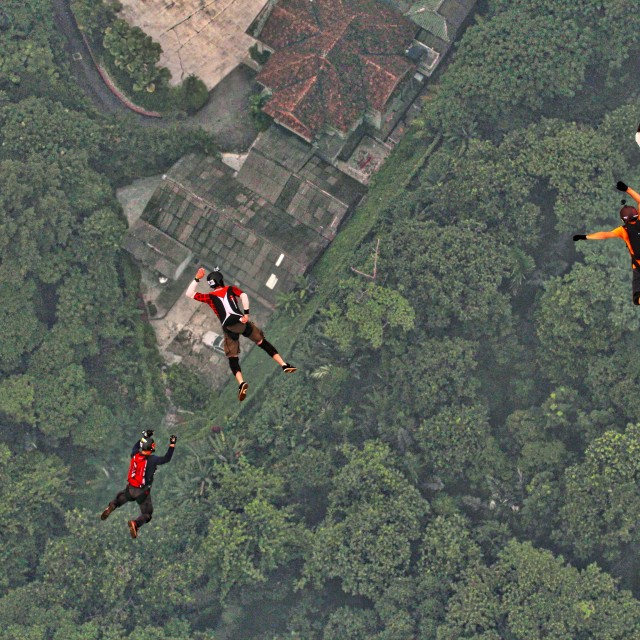 """Three BASE jumpers at KL International BASE jump 2015"" stock image"