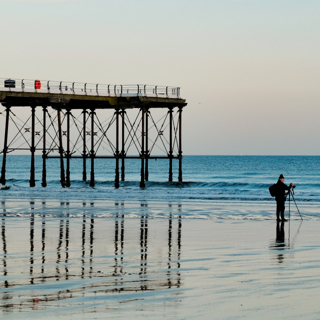 """Photographer on the beach at Saltburn Pier"" stock image"