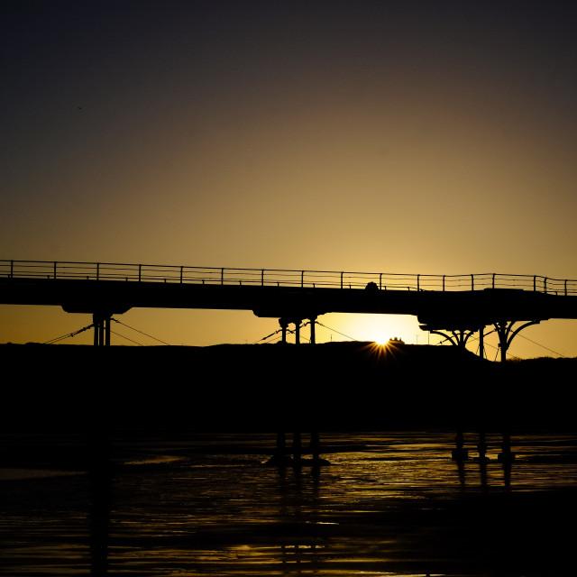 """""""Sunrise under Saltburn Pier"""" stock image"""