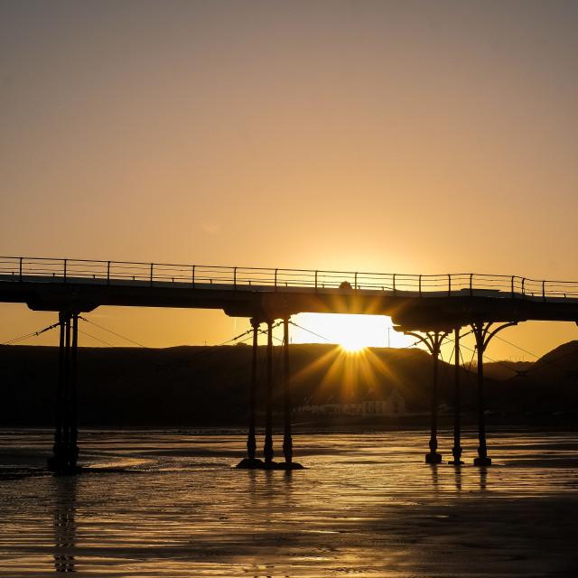 """Sunrise under Saltburn Pier (upright)"" stock image"