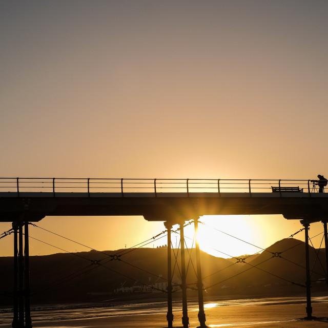 """Photographer on Saltburn Pier at sunrise"" stock image"