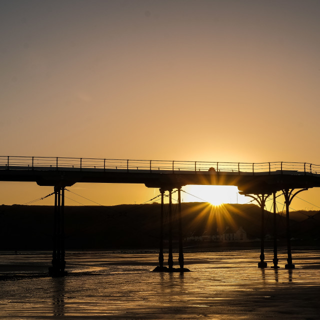 """Autumn sunrise under Saltburn Pier"" stock image"