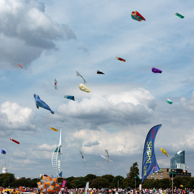 """Portsmouth International Kite Festival 2015 - various kites in the blue and cloudy sky"" stock image"