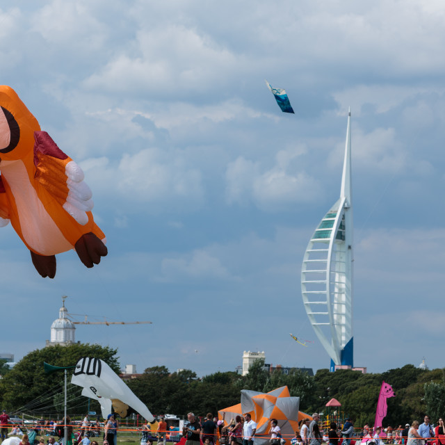 """Portsmouth International Kite Festival 2015 - orange owl kite taking off"" stock image"