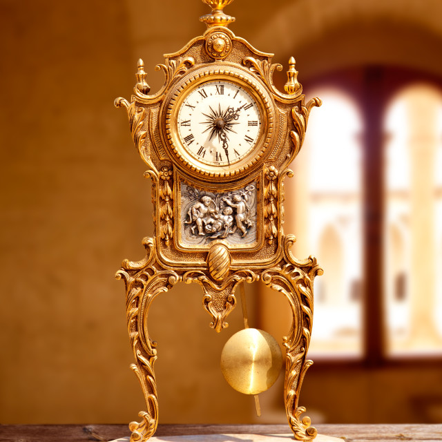 """ancient vintage golden brass pendulum clock"" stock image"