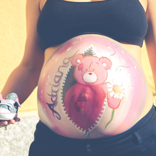 """""""Drawing on the abdomen of a pregnant"""" stock image"""