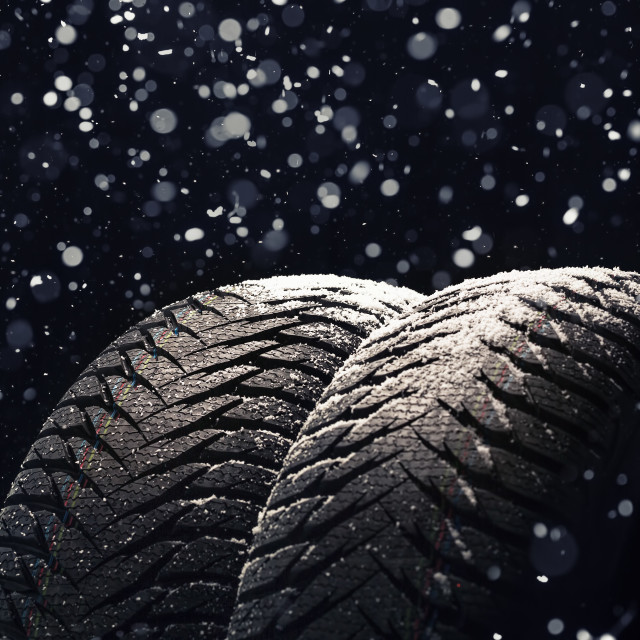 """Winter Car tires with snow on black"" stock image"