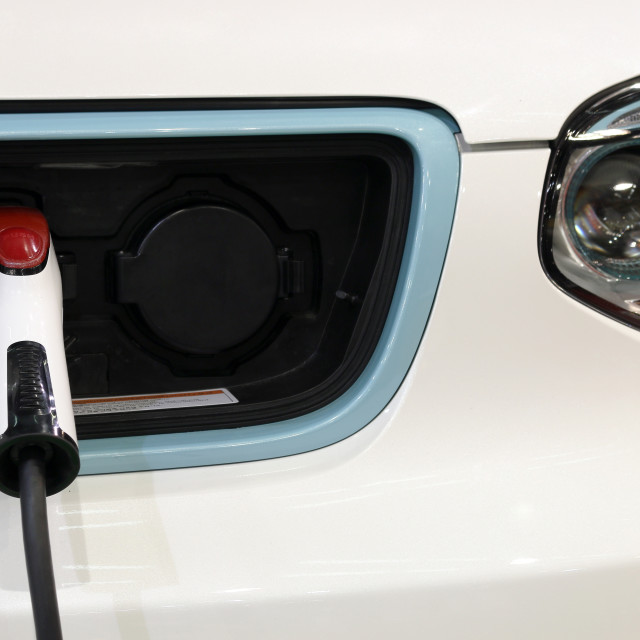"""hybrid car is charging new technology"" stock image"