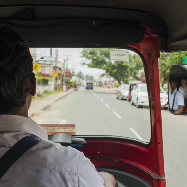 """""""A tuk tuk driver on the road"""" stock image"""