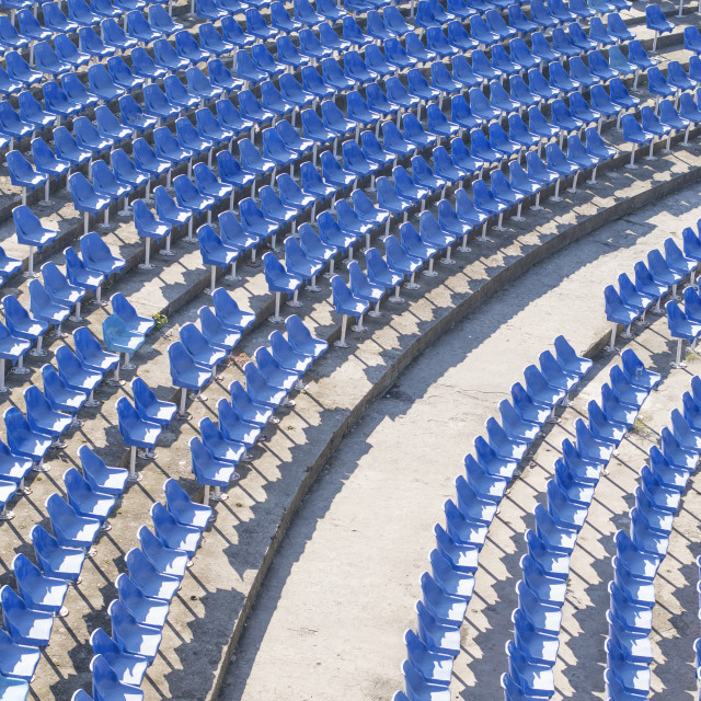 """Blue chairs in an empty amphitheater hall"" stock image"