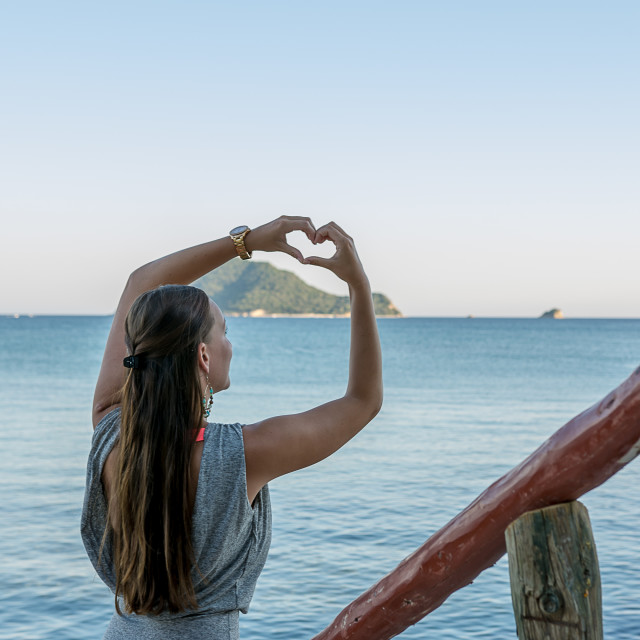 """Young woman creating a hart"" stock image"